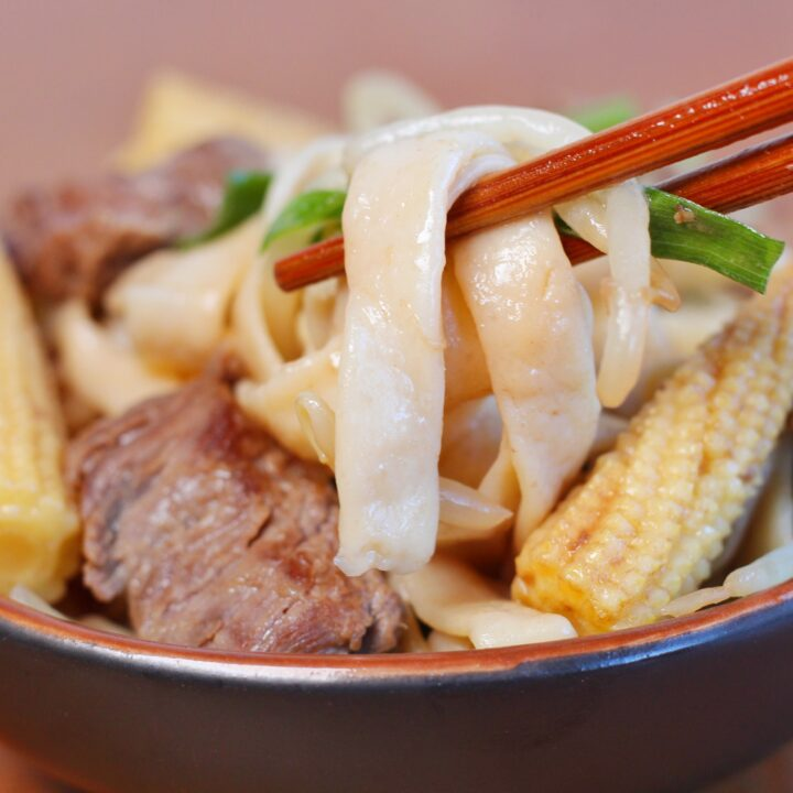 This is a low carb noodle dishes with slices of tender beef, baby corn, and diced green onions.