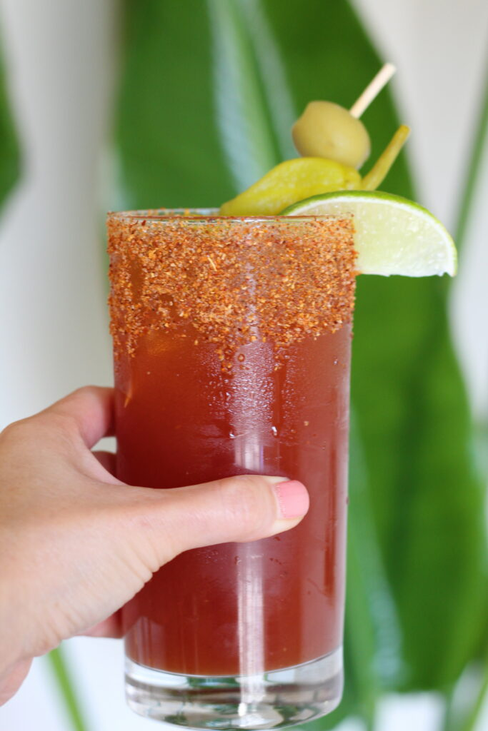 low carb michelada with a tajin rim, lime wedge